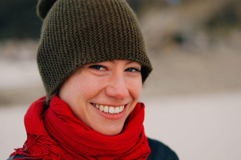 Cheerful Close-up Day Focus On Foreground Happiness Headshot Knit Hat Looking At Camera One Person Outdoors People Portrait Real People Red Scarf Smiling Warm Clothing Winter Young Adult Young Women