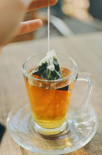 Food And Drink Drink Human Hand Human Body Part Refreshment Hand One Person Tea Close-up Freshness Table Food Real People Hot Drink Tea - Hot Drink Focus On Foreground Body Part Glass Unrecognizable Person Indoors  Tea Cup Finger Crockery