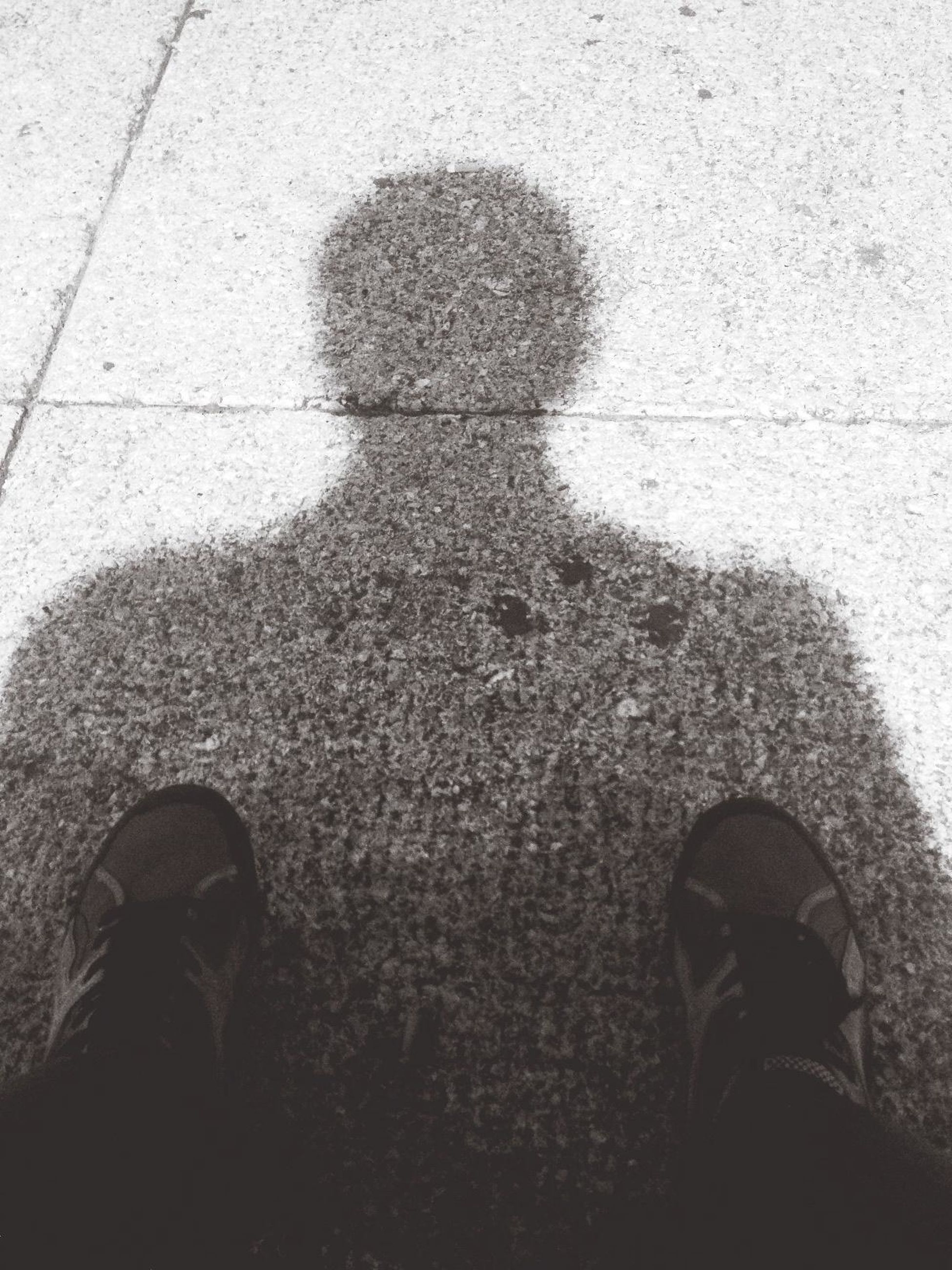 lifestyles, low section, shoe, high angle view, standing, person, men, shadow, street, personal perspective, leisure activity, unrecognizable person, focus on shadow, footwear, outdoors, human foot, day