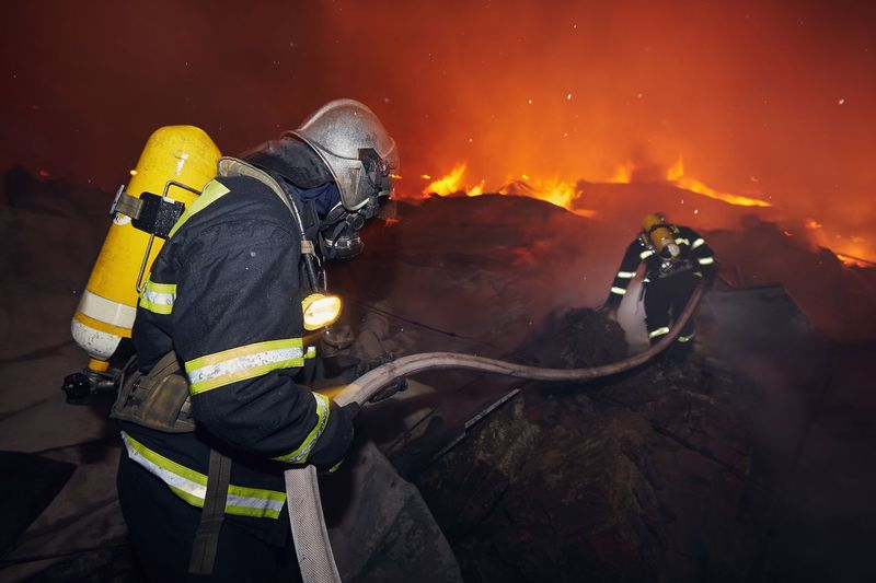 Firefighters working outdoors