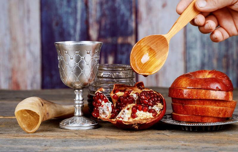 Honey, apple and pomegranate for traditional holiday symbols rosh hashanah jewesh holiday on wooden white background. Rosh Hashana Yom Kippur Jewish New Year Kippah Kosher Kosher Food Kosher Symbol Pomegranate Rosh Hashanah Shofar Synagogue Tishrei Tova