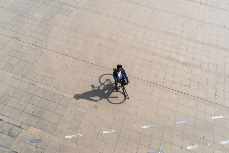 High angle view of person riding bicycle