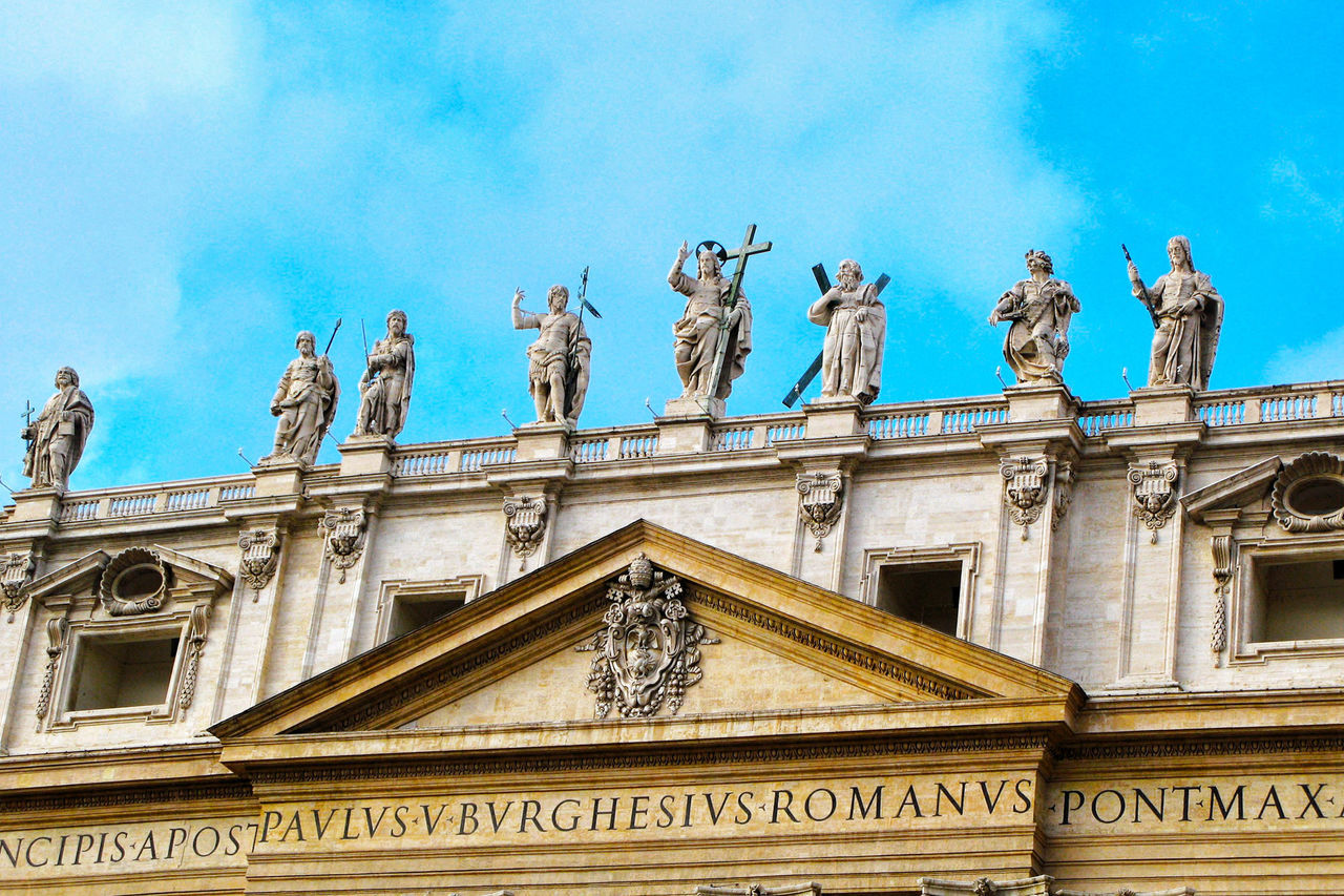 architecture, statue, building exterior, low angle view, built structure, sculpture, art and craft, outdoors, cloud - sky, human representation, day, sky, travel destinations, facade, no people, politics and government, city, royal person