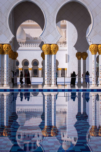 Reflection of buildings in swimming pool