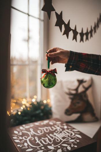 Hand holding christmas decoration