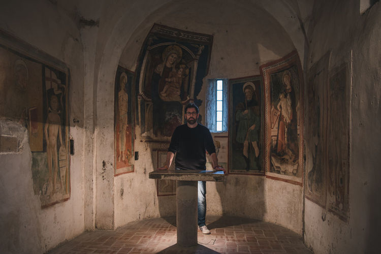 Portrait of man standing in church