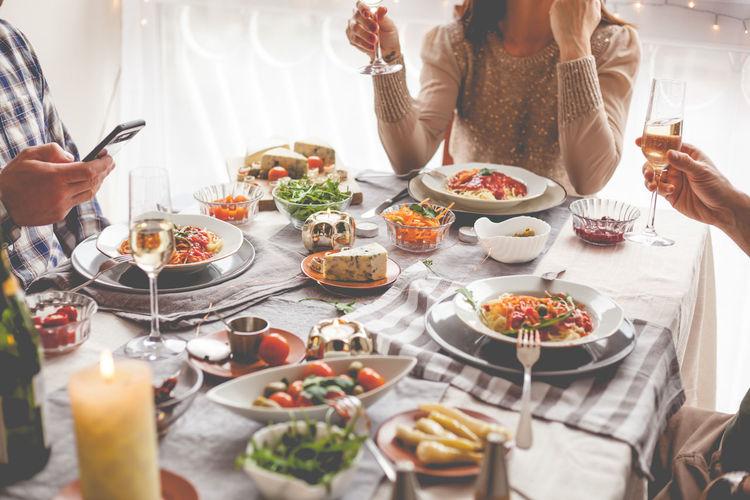 Group Of People Friends Celebration Food And Drink Food Real People Plate Table Freshness Glass Lifestyles Indoors  Adult Ready-to-eat Drink Meal People Human Hand Holding Wellbeing Hand Woman Lunch Weekend Activities Smart Phone
