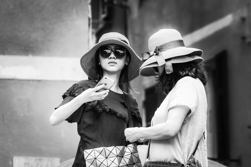 Two hats are better than one EyeEm Selects Two People Sunglasses Real People Friendship Togetherness Outdoors Women Lifestyles People Streetphotography