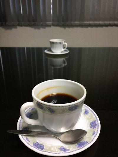 Two cups of black coffee on a mirrored wooden table with a reflection of window blinds. Refreshment Drink Saucer Food And Drink Coffee Cup Table Cup Indoors  No People Coffee - Drink Freshness Close-up Healthy Eating Day Black Coffee Caffeine Morning Meeting Conference Business Discussion Detox Healthy Diet Sugar Free