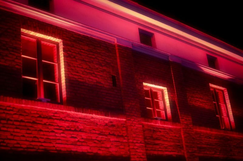 Low angle view of red building at night