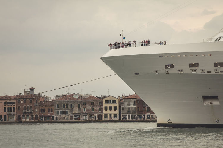 Cruise ship on grand canal against sky