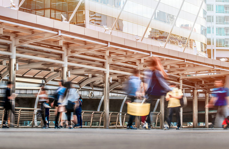 Motion Architecture Blurred Motion Group Of People Real People Built Structure Men Transportation Lifestyles City Women Leisure Activity Walking Crowd Large Group Of People Mode Of Transportation Day Building Exterior City Life Adult People Skywalk Rush Hour Busy