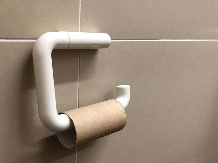 Close-up of empty paper roll in bathroom
