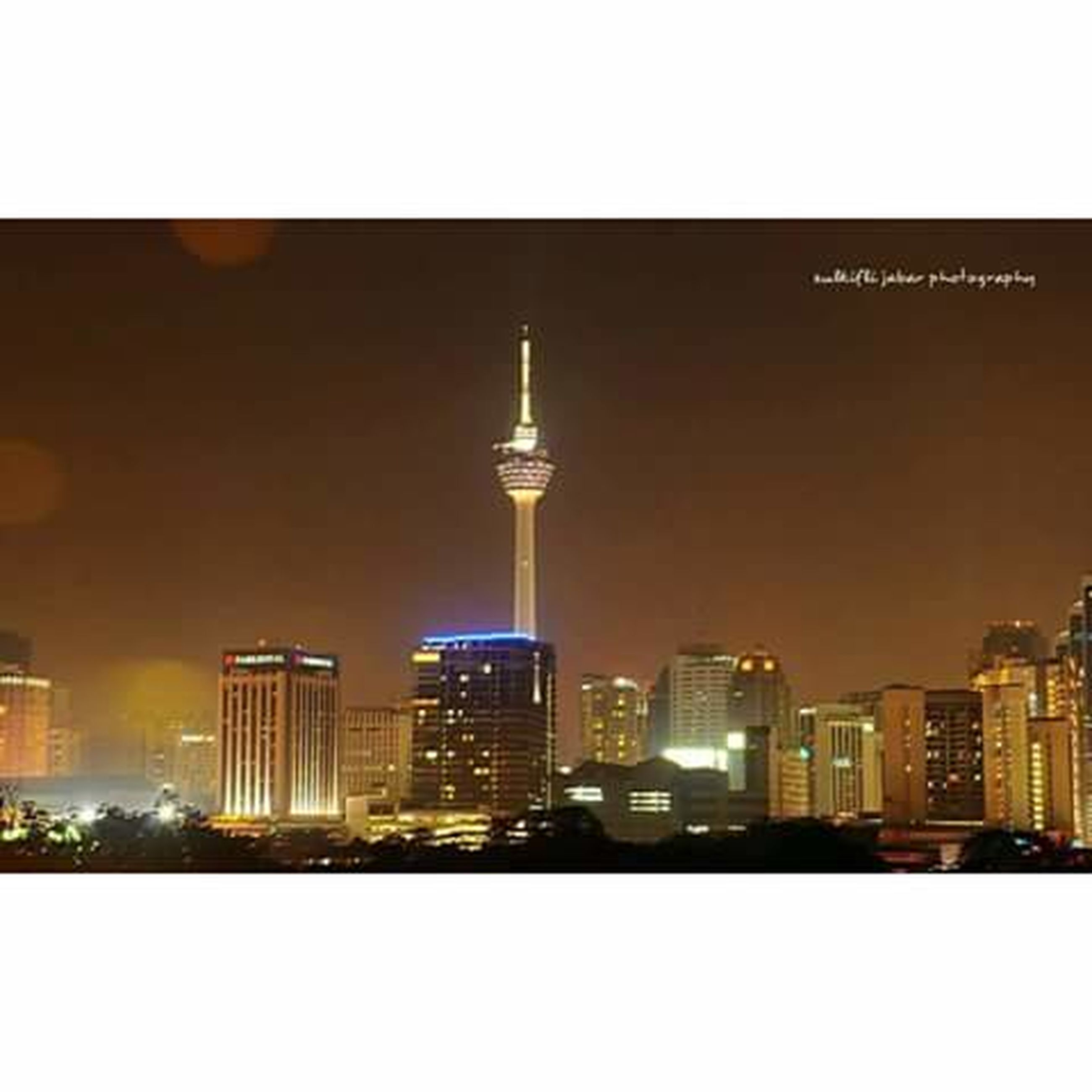 built structure, architecture, city, communications tower, illuminated, building exterior, tower, night, skyscraper, tall - high, cityscape, communication, spire, modern, sky, travel destinations, tall, outdoors, urban skyline, city life, television tower, office building, culture, no people, development, building story, skyline