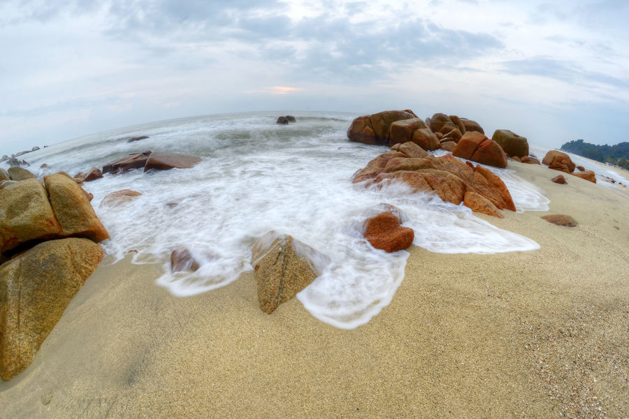 the beach thru fish eye lens Seascape Photography Rock - Object Motion Fish Eye Lens Stone Sunrise Photography Slow Shutter Effects Beach Sea Sand Cloud - Sky Water Vacations Nature Wave Beauty In Nature Sky Day No People Outdoors