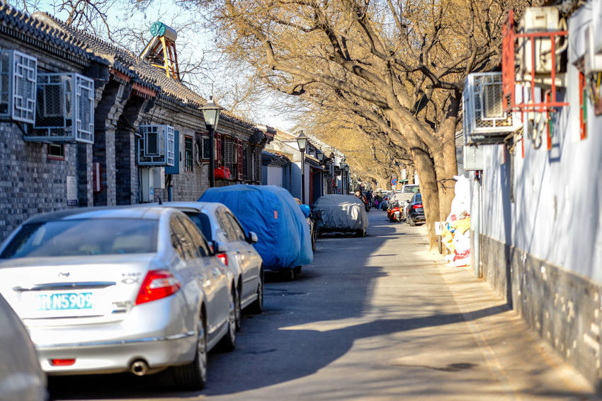 BEIJING, CHINA - MARCH 10, 2016: The old Beijing hutong with its narrow streets, with its exotic and modern vehicles. ASIA Beijing Delivery Goods Lifestyle Peking  Road Scooter Service Tourist Traffic Transportation Travel Bicycle Bicycles Capital China Ecology Hutong Hutong Street Motorcicle Street Tourism Urban Vehicle