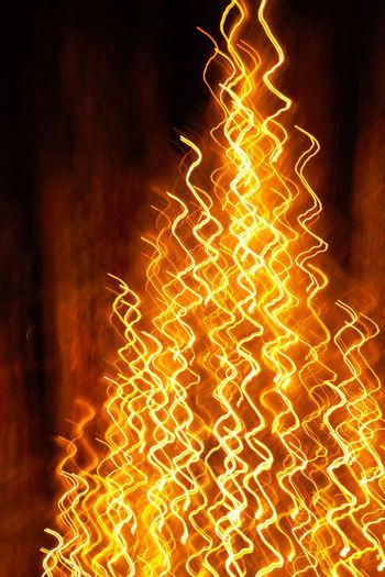 Close-up of illuminated fire at night