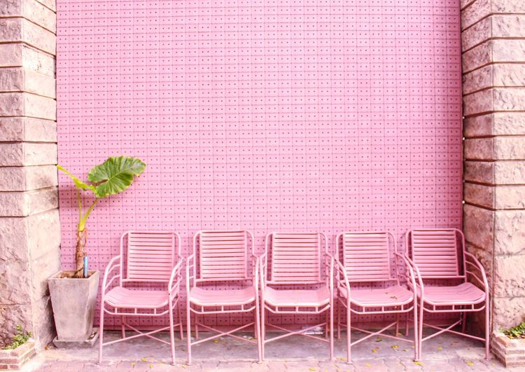 Many pink chairs are wait for us to sit Chair Outdoors Day Nature Thailand Vacation Pink Wall Brick Order Sitting Sitting Outside Cute Pretty Time Relax Fresh On Market 2017