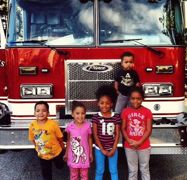 Looking At Camera Child Portrait Boys Childhood Innocence Front View Greeting Fire Engine People Responsibility Togetherness Outdoors Adult Firefighter Day 9/11/2001 Grandbabies Babies Of Eyeem