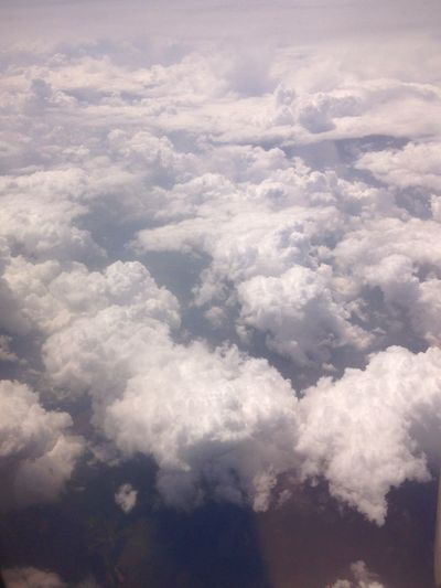 white clouds in the sky over a plane wing Airplane Plane Water Mountain Planet Earth Splashing Droplet Blue Cloud Computing Heaven Spirituality Cumulus Cloud Wispy Sky Only Fly Cumulus Hovering Meteorology Cloudscape Cumulonimbus Stratosphere