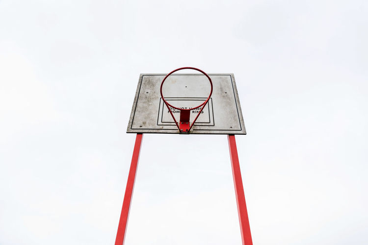 empty outdoor basketball over clody british sky Basketball Basketball Hoop Architecture Basketball - Sport Day No People Outdoors Red Sport Street Ball