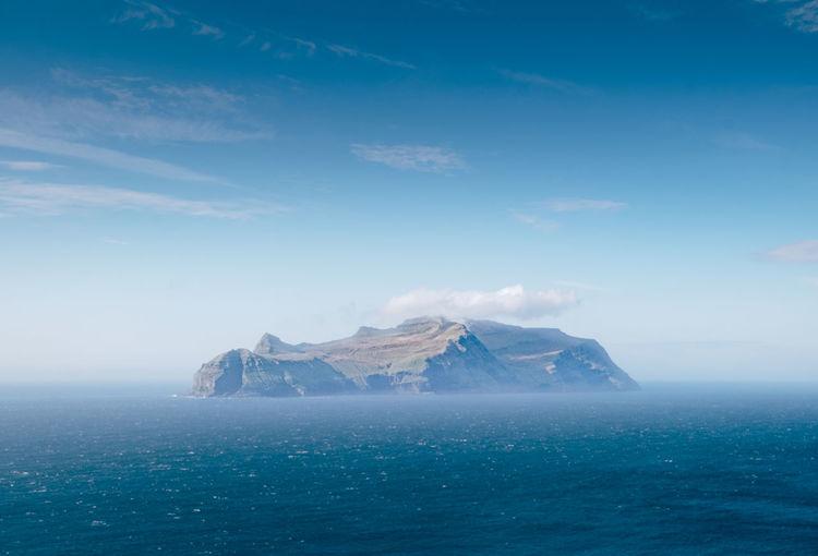 Island against sea and sky