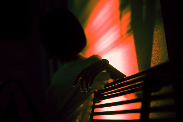 Indoors  Night One Person Red Music Adult Multi Colored Light - Natural Phenomenon Selective Focus Technology Close-up Event Burning Occupation Silhouette Illuminated Men Stage Nightlife