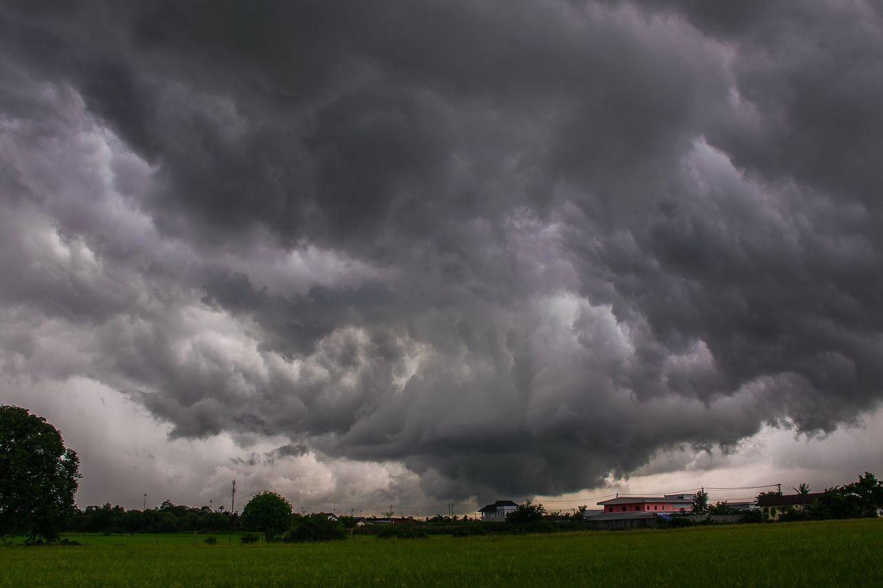 Landscape Against Cloudy Sky At Dusk