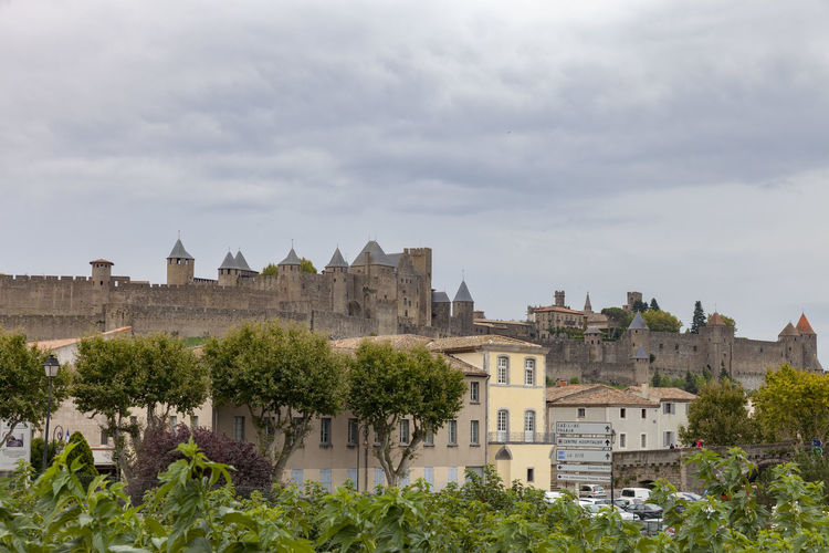 Carcassone Built Structure Architecture Building Exterior Building Plant Sky Nature Tree Cloud - Sky Day Residential District City The Past No People History Outdoors Travel Destinations Castle Growth House MedievalTown Tourist Attraction  Tourist City Medieval City