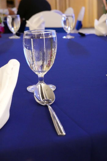 Close-up of wine glasses on table in restaurant