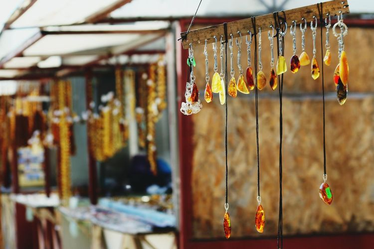 Close-Up Of Key Rings And Pendants At Market Stall