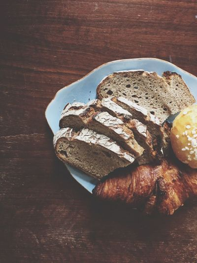 High angle view of breakfast on wooden table