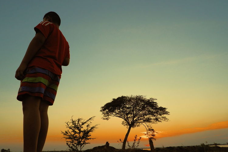 Sky Sunset Rear View Real People One Person Nature Tree Men Plant Clear Sky Standing Lifestyles Casual Clothing Orange Color Outdoors Leisure Activity Three Quarter Length Land Low Angle View