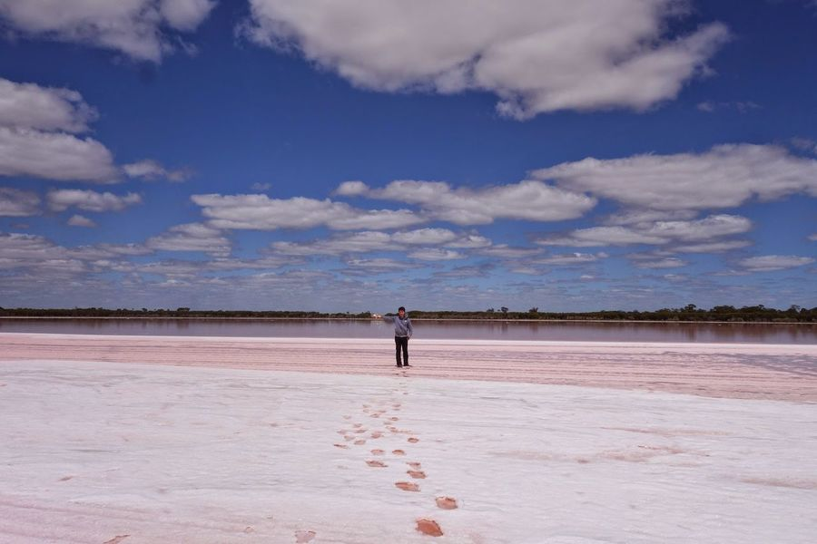 Adult Adults Only Arid Climate Beauty In Nature Cloud - Sky Day Desert Full Length Landscape Nature One Man Only One Person Only Men Outdoors People Pink Lake Salt - Mineral Salt Basin Salt Flat Salt Lake Sand Sky Standing