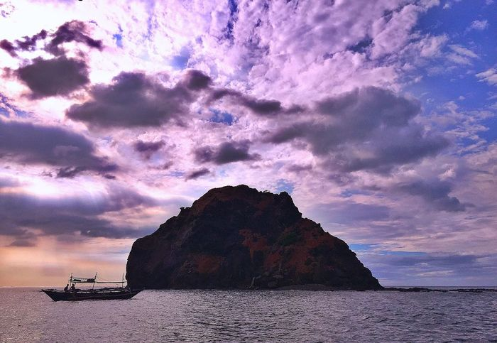 Slow and steady wins the race 🚣 Sea Beauty In Nature Nature Scenics Rock Formation Rock - Object Sky Tranquil Scene Water Idyllic Tranquility Outdoors Cloud - Sky Mountain No People Natural Arch Day Zambales Jaysalvarez Photography Capones Island