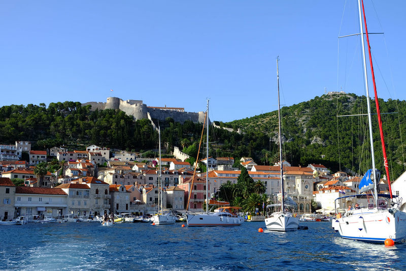 Architecture Beach Castle Clear Sky Croatia Day Harbor Hill Mast Moored Nautical Vessel No People Outdoors Sailboat Sailing Ship Sea Tourism Travel Travel Destinations Vacations Water Waterfront Yacht Yachting