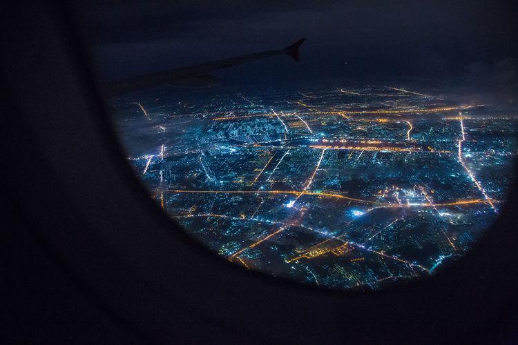 Close-up of illuminated window against sky at night