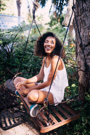 African Happy Woman Smiling Swing