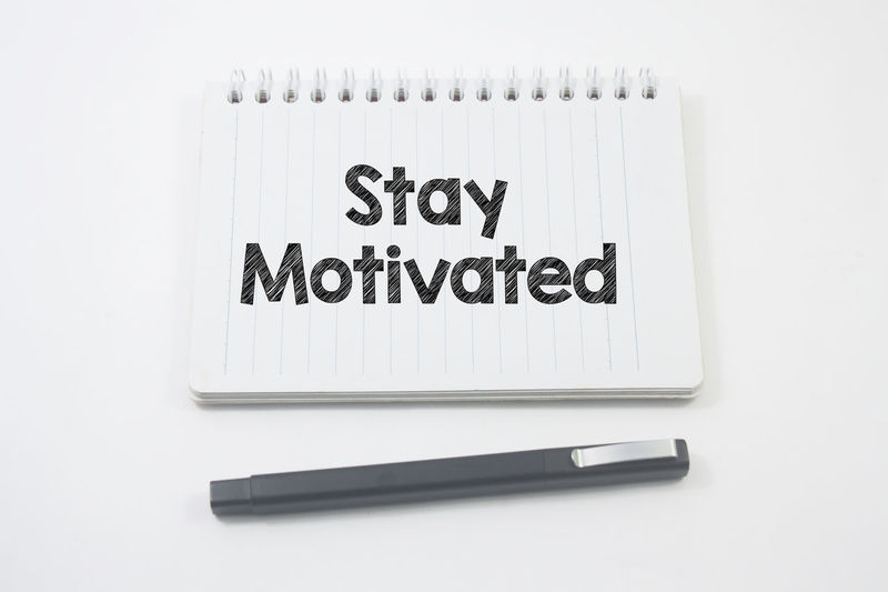 pen and notebook written stay motivated over white background Evolution  Inspirations Inspiring Start Know Quotes Stay Motivation Knowing EyeEm Best Shots White Background Close-up Handwriting  Note Adhesive Note Text Capital Letter