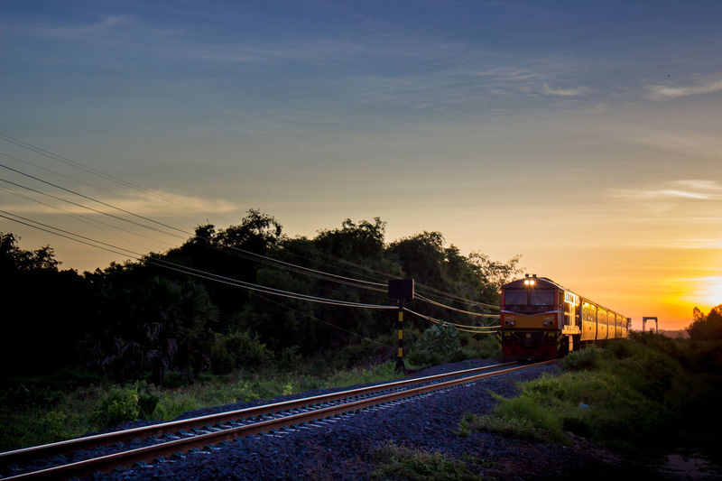 Evening train Black & White Blue Sky Day Evening Light Evening Sky Evening Sun Evening Time Evening Train Full Frame Thailand Train Trees