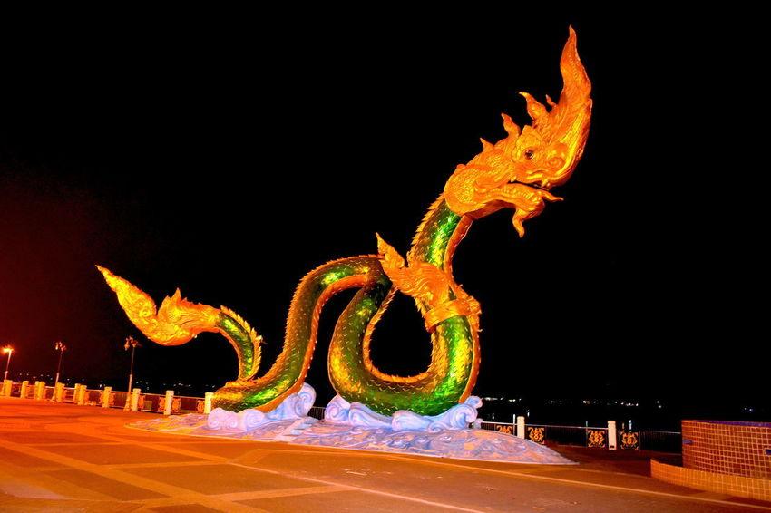 Gold And Green Belief Gold And Green Giant Naga Statue By The Mekong River At Nig Gold And Green Naga Illuminated Naga Concrete Statue Naga Statue Night