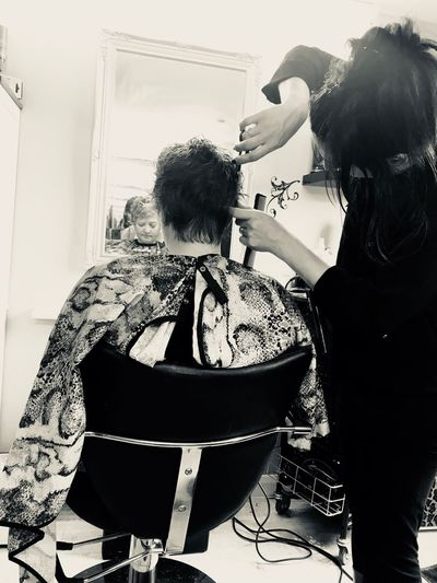 Getting a hair cut Hairdressing Equipment Hairdressing Work Hair And Beauty Beauty Industry Hairdresser Cutring Hair Salon Hairdressing Real People Indoors  Lifestyles Sitting Young Women Young Adult Women People Human Connection