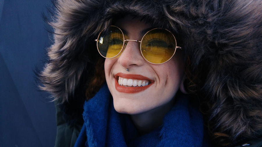 Close-up Clothing Cold Temperature Fashion Front View Fur Fur Hat Glasses Hairstyle Happiness Headshot Human Face Leisure Activity Lifestyles Looking At Camera One Person Portrait Real People Scarf Smiling Sunglasses Toothy Smile Warm Clothing Winter
