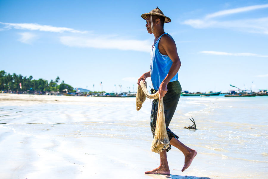 Beach Beauty In Nature Casual Clothing Day Fisherman Fishernet Full Length Hat Leisure Activity Lifestyles Men in Ngapali Beach, Myanmar Outdoors Real People Sand Sea Sky Standing Sunlight Water Young Adult Young Men Sommergefühle