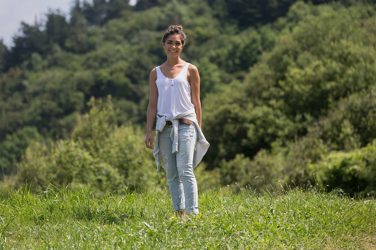A very casual moment on a trail Casual Clothing Day Field Focus On Foreground Full Length Grass Grassy Green Green Color Growth Landscape Leisure Activity Lifestyles Nature Outdoors Plant Portrait Selective Focus Standing Tranquility Tree