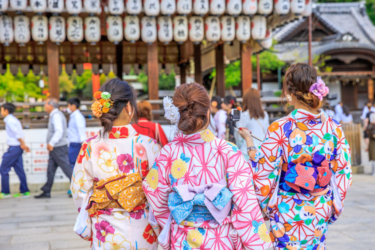 Three Japanese women in kimono take picture of paper lanterns of Yasaka Shrine in Kyoto, Japan. Gion Shrine is one of the most famous shrines in Kyoto between Gion District and Higashiyama District. Kyoto Kyoto,japan Kyoto, Japan Japan Temple Zen Buddist Temple Garden Tree Shrine Torii Gate Lake Garden Flowers Nature Meditation Japanese  Honden Yasaka Shrine Yasaka Pagoda Gion Shrine Gion Kyoto Higashiyama Pagoda Shinto Lifestyles Traditional Clothing Women Group Of People Rear View Adult Real People Architecture Clothing City Leisure Activity People Focus On Foreground Day Kimono Street Incidental People Outdoors
