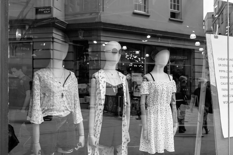 Mannequins At Window Display In Shop
