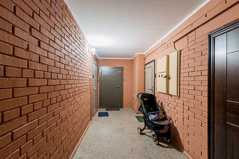 People in corridor of building