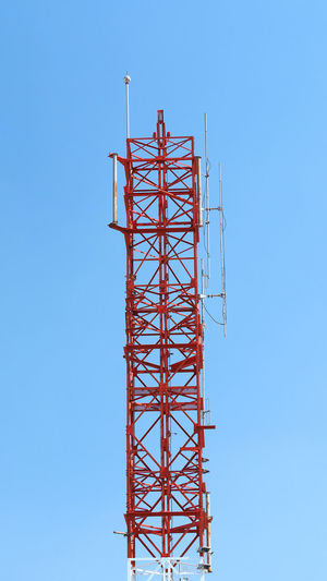 Telecommunication tower red and white color and blue sky. Day Metal No People Outdoors Red Telecom Telecommunication Telecommunications Equipment Tower Tower; Sky; Telecommunication; Post; Communication; Blue; Technology; Telephone; Background; Connection; Network; Phone; Mobile; Wireless; Equipment; Signal; Antenna; Broadcast; Radio; Industry; Steel; Station; White; Cloud; Internet; Red; High; City; Big