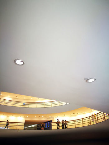 People Walking Inside Building Low Angle View Ceiling Halloween Architecture Built Structure Copy Space Downlights Illuminated Indoors  Lamp Low Angle View People Real People Walking